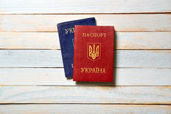 Two Ukrainian passports lying on a wooden table Stock Image