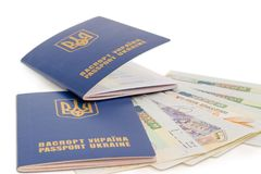 Two Ukrainian passports on the travel visas closeup. Two Ukrainian passports on the several travel visas closeup at shallow depth of field on a white background Stock Photo