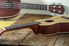 Two ukuleles. Ukuleles  against a wooden background Stock Photo