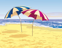 Two umbrellas. Two striped umbrellas on the beach Stock Photography