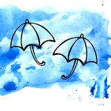 Two umbrellas. On blue watercolor background Royalty Free Stock Photography