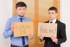 Two unemployed men looking for a job. Stock Photo