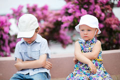 Two unhappy kids outdoors Stock Photo