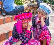 Two unidentified Akha children pose for tourist photos at Wat Phratat Doi Suthep on in Chiang Mai, Thailand. royalty free stock photos