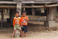 Two unidentified boys smiles for the camera in the suburb of Nha Trang. royalty free stock images