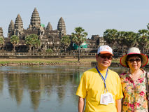 Two unidentified Traveler stand at Angkor Wat Royalty Free Stock Photo