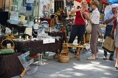Two unidentified women make a purchase at a flea market near the city center. Editorial only. Royalty Free Stock Photography