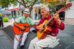 Two unidentify indigenous men playing guitar in Royalty Free Stock Photos
