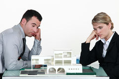 Two uninspired architects Stock Images