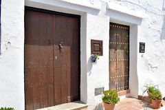 Two unique art doors  in Frigiliana, Spanish white village Andalusia. Beautiful and charming with its narrow streets and paths white village Frigiliana, close Stock Images