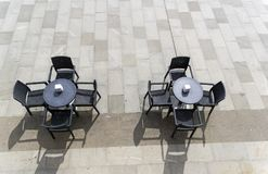 Two unoccupied tables in a street cafe. Royalty Free Stock Images