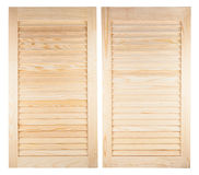Two unpainted wooden shutters Stock Images