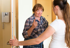 Two unpleased women at doorway Royalty Free Stock Photography