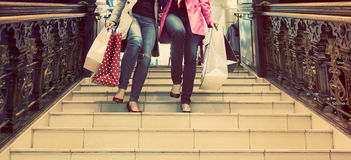Two unrecognisable young female friends enjoying a day out shopping Stock Photo