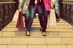 Two unrecognisable young female friends enjoying a day out shopping Royalty Free Stock Photography