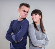 Upset friends back to back Royalty Free Stock Photo