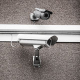 Two urban security cameras Stock Photos