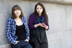 Two urban smiling teen girls Stock Photo