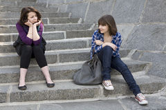 Two urban teen girl sitting on stairs royalty free stock image