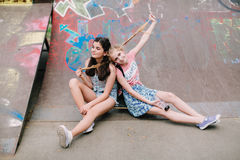 Two urban teen girls posing in skate park Stock Photography