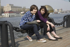 Two urban teen girls sitting on stairs Stock Photos