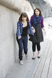 Two urban teen girls trying Royalty Free Stock Photo