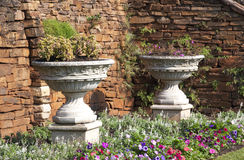 Two Urn Flower Pots in Garden Setting Royalty Free Stock Photos