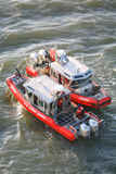 Two US Coast Guard powerboats in East River Royalty Free Stock Photos
