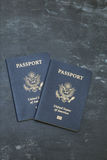 Two US passports on black background Stock Photography