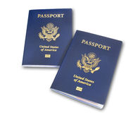 Two US passports, isolated. Two angled US American passports isolated on white with shadow and clipping path Royalty Free Stock Image