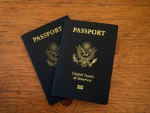 Two US Passports on a Wooden Table Royalty Free Stock Images