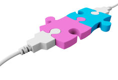 Two usb cables will connect two pieces of puzzle. Two pieces of the puzzle are joined together and both are connected to the usb cables Royalty Free Stock Photography
