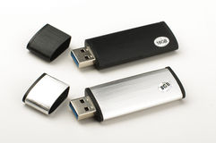 Two USB pen drives isolated on the bright background Stock Photos