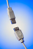 Two usb plugs on blue Royalty Free Stock Image