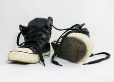 Used shoes. Two used shoes isolate on white background royalty free stock images