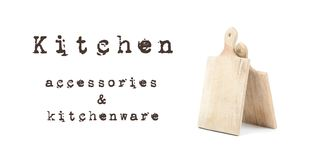 Two used wooden cutting boards isolated on white background with written sign Kitchen accessories and kitchenware. Dark brown lett. Ers on white surface. Cooking royalty free stock photography