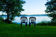 Two vacant places. Available, empty chairs by a lake Royalty Free Stock Photos