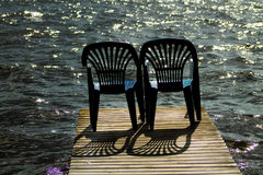 Two vacant places. Available, empty chairs by a lake Royalty Free Stock Images