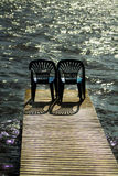 Two vacant places. Available, empty chairs by a lake Royalty Free Stock Image