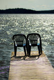 Two vacant places. Available, empty chairs by a lake Royalty Free Stock Photography