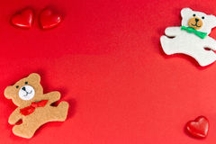 Two Valentine's bears with hearts. Cute teddy bears with red hearts Stock Photography