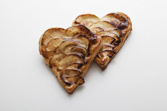 Two Valentine's Day apple pies. Two Valentine's Day heart-shaped apple pies on a white surface Royalty Free Stock Images
