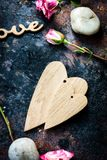 Two Valentine's day hearts together on rustic background.  stock images