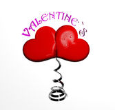Two valentine `s hearts on metal spring Stock Image
