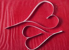 Two valentine\\\'s paper hearts Stock Images