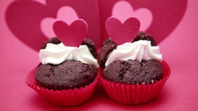 Two valentines cupcakes. Focus on two valentines cupcakes stock video