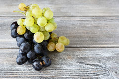 Two varieties of Grapes on the boards Royalty Free Stock Image