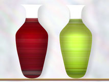 Two Vases. Full of light and color on display on a shelf Royalty Free Stock Image