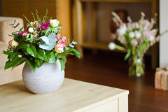 Two vases with flowers in modern interior Royalty Free Stock Photos