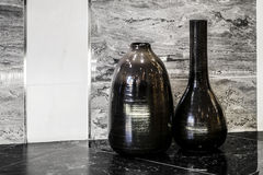 Two vases standing on Granite tile with Marble wall Royalty Free Stock Photography
